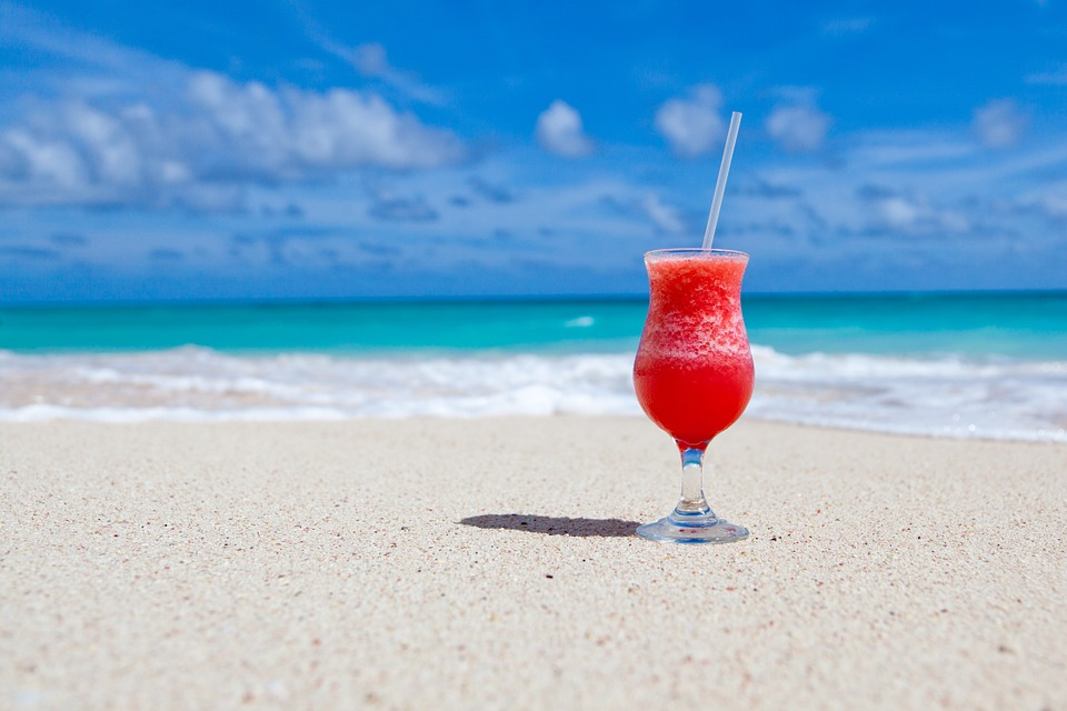 drinking cocktails on the beach while thinking about learning French in September